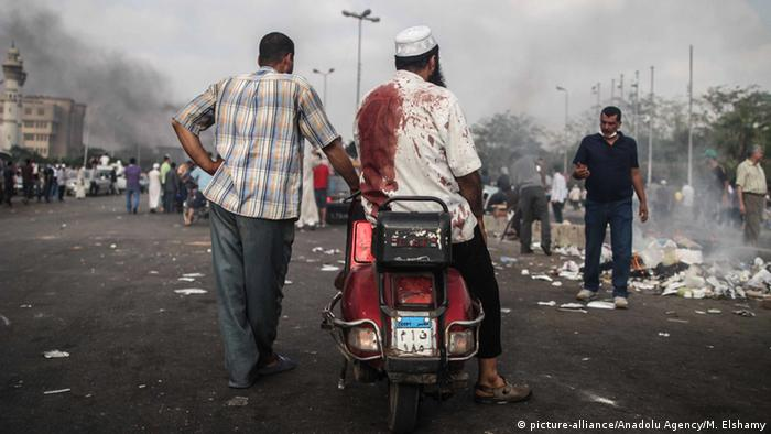 A pro-Morsi supporter after police violently cleared a sit-in