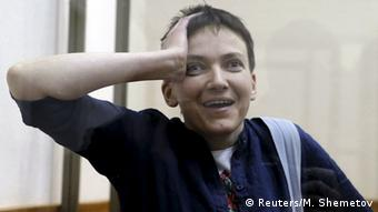 Savchenko gestures from inside a glass-walled cage during a verdict hearing at a court in Russia