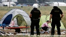 24.05.2016 Police officers patrol among tents during an evacuation operation by police forces of a makeshift migrant camp at the border at the Greek-Macedonian border near the village of Idomeni, on May 24, 2016. In an operation which began shortly after sunrise on May 24, hundreds of Greek police began evacuating the sprawling camp which is currently home to 8,400 refugees and migrants, among them many families with children, an AFP correspondent said. At its height, there were more than 12,000 people crammed into the site, many of them fleeing war, persecution and poverty in the Middle East and Asia, with the camp exploding in size since Balkan states began closing their borders in mid February in a bid to stem the human tide seeking passage to northern Europe. / AFP / POOL / YANNIS KOLESIDIS (Photo credit should read YANNIS KOLESIDIS/AFP/Getty Images) (c) Getty Images/AFP/Y.Kolesidis/Pool
