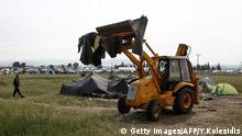 24.05.2016 An excavator collects tents during an evacuation operation by police forces of a makeshift migrant camp at the border at the Greek-Macedonian border near the village of Idomeni, on May 24, 2016. In an operation which began shortly after sunrise on May 24, hundreds of Greek police began evacuating the sprawling camp which is currently home to 8,400 refugees and migrants, among them many families with children, an AFP correspondent said. At its height, there were more than 12,000 people crammed into the site, many of them fleeing war, persecution and poverty in the Middle East and Asia, with the camp exploding in size since Balkan states began closing their borders in mid February in a bid to stem the human tide seeking passage to northern Europe. / AFP / POOL / YANNIS KOLESIDIS (Photo credit should read YANNIS KOLESIDIS/AFP/Getty Images) (c) Getty Images/AFP/Y.Kolesidis