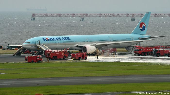 A Boeing 777 Korean Air flight is evacuated at Tokyo's Haneda airport