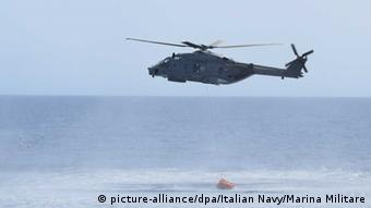 A helicopter is seen during the rescue operation of a capsized boat at Sicilian Strait, between Libya and Italy, in the Mediterranean on May 25, 2016.