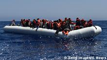 Migrants and refugees wait for help during a rescue operation at sea of the Aquarius, a former North Atlantic fisheries protection ship now used by humanitarians SOS Mediterranee and Medecins Sans Frontieres (Doctors without Borders), on May 24, 2016 in the Mediterranean sea in front of the Libyan coast. / AFP / GABRIEL BOUYS (Photo credit should read GABRIEL BOUYS/AFP/Getty Images)