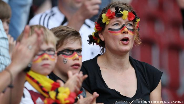 Germany football fans at a match, Copyright: picture-alliance/dpa/C. Charisius