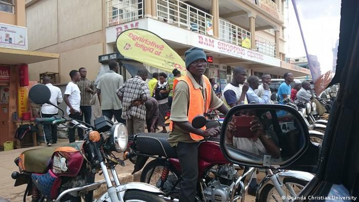 A man sitting on a motorcycle taxi in Uganda (Uganda Christian University)