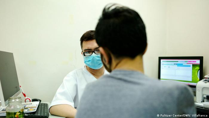 An HIV positive patient consults a nurse trained to attend to those infected with the virus