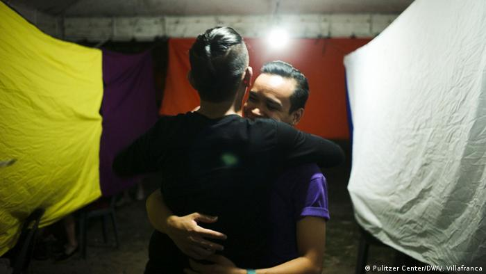 A couple hugs after the culmination of AIDS day activities in December 2015 in Cebu City