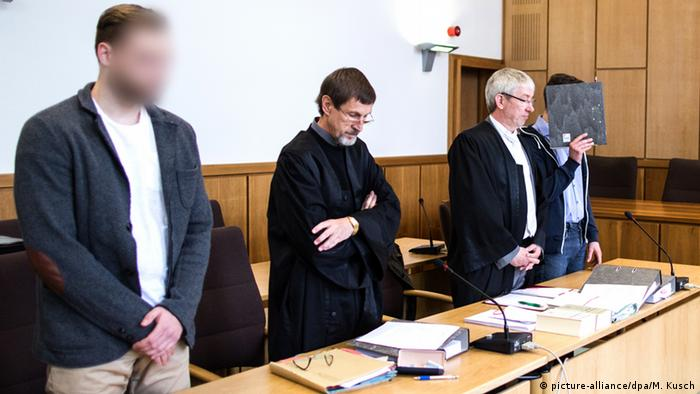 Two arson suspects stand trial in Germany for setting fire to a refugee house in Altena