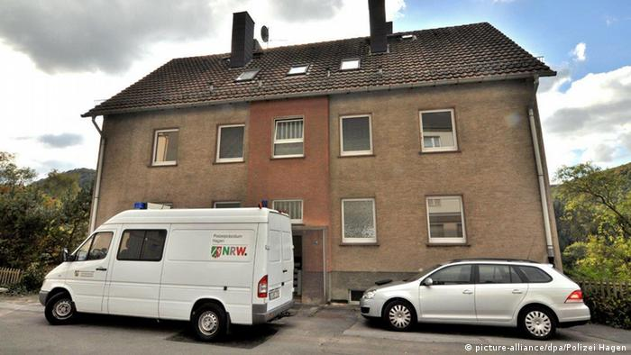 Police arrive at a refugee house after arsonists set fire to it in the town of Altena, Germany