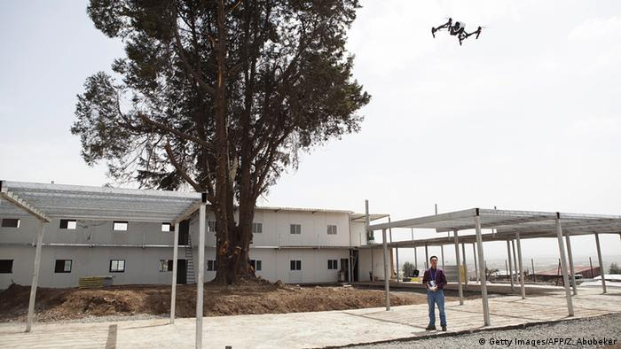 A Chinese worker flies a drone in the Ethiopian capital Addis Ababa.