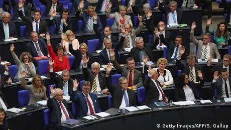 German politicians vote in the Bundestag