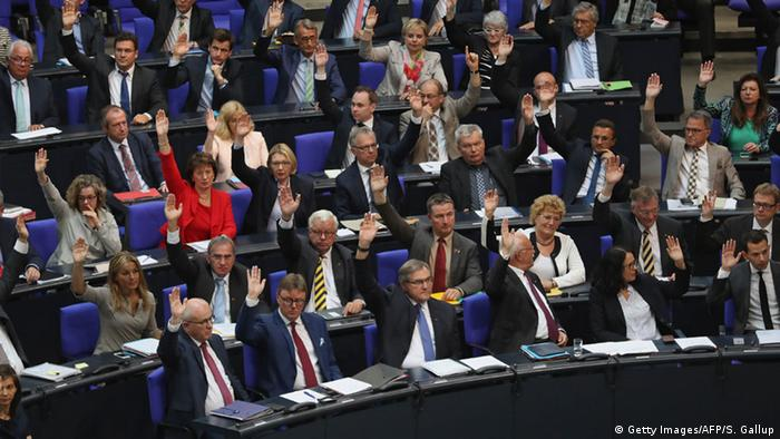German politicians vote in the Bundestag