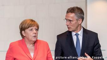Merkel and Jens Stoltenberg