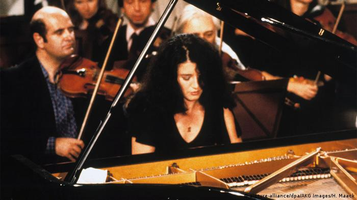 Martha Argerich performs in 1982 at the piano with an orchestra behind her