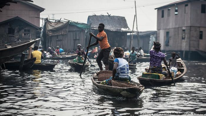 People travel by canoe in the floating slum of Makoko, Nigeria