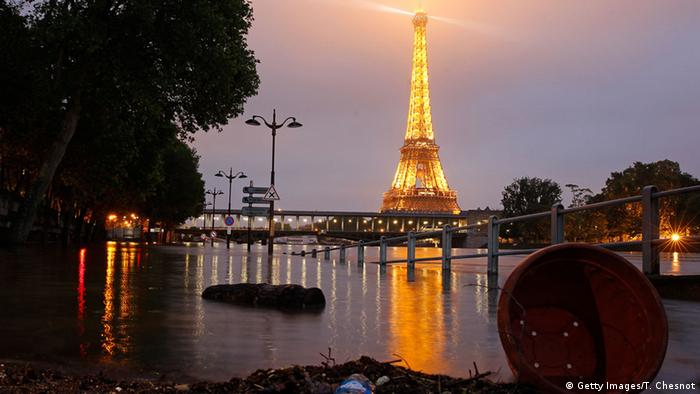 Water rises by night near the area of the Eiffel Tower as the Seine river's embankments overflow after four days of heavy rain on June 2, 2016 in Paris, France (Photo: Getty Images/T. Chesnot)