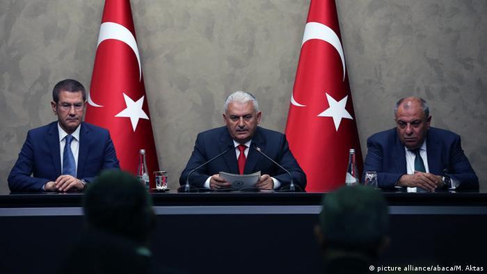Canikli (left) with PM Binali Yildirim and Deputy PM Tugrul Turkes (right)