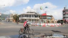 (150515) --BUJUMBURA, May 15, 2015 -- A Burundian cycles past the city center of Bujumbura, Burundi, May 15, 2015. Burundian President Pierre Nkurunziza returned to the capital Bujumbura on Friday and is expected to address the nation later after a coup attempt staged by a top general was foiled by the army. +++ (C) Imago/Xinhua Afrika