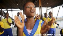 A girl sings during morning devotion before the start of classes at a floating school in the Makoko fishing community on the Lagos Lagoon, Nigeria February 29, 2016. In Makoko, a sprawling slum of Nigeria's megacity Lagos, a floating school capable of holding up to a hundred pupils has since November brought free education to the waterways known as the Venice of Lagos. It offers the chance of social mobility for youngsters who, like most of the city's 21 million inhabitants, lack a reliable electricity and water supply and whose water-based way of life is threatened by climate change as well as rapid urbanisation. +++ (C) Reuters/A. Akinleye