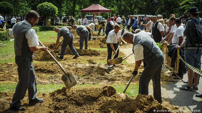 General view of the first National Grave Digging competition at the public cemetery of Debrecen, Hungary