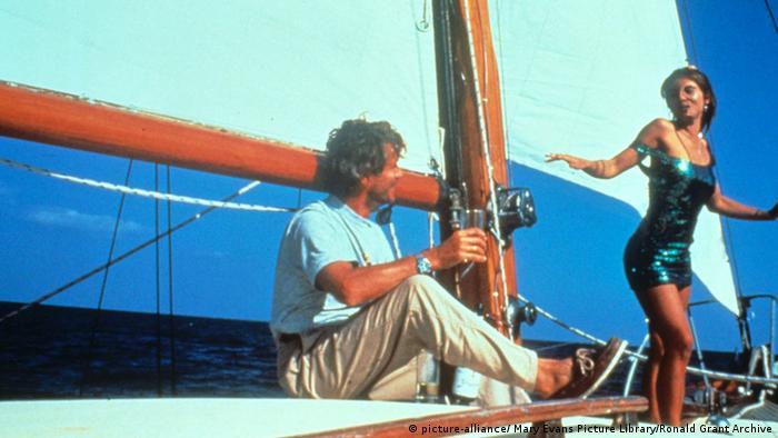 Jürgen Prochnow on a sailboat with Elizabeth Hurley in Kill Cruise.