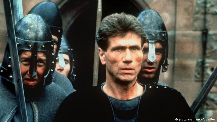 Jürgen Prochnow in Robin Hood with soliders in the background.