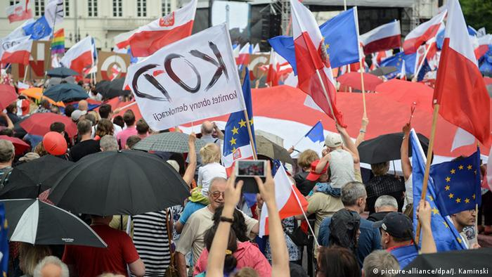 People take part in the march organised by Polish Committee for the Defense of Democracy (KOD) in Warsaw on June 4