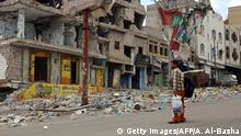 7.4.2016*** A picture taken on April 7, 2016, shows heavily damaged buildings on a street in Yemen's third city Taez as a result of clashes between Shiite Huthi rebels and fighters from the Popular Resistance Committees, loyal to Yemen's fugitive President Abedrabbo Mansour Hadi. A new ceasefire enters into effect in Yemen midnight on April 10, 2016, with the United Nations hoping it can be the cornerstone of a long-lasting peace deal at upcoming talks in Kuwait. / AFP / AHMAD AL-BASHA (Photo credit should read AHMAD AL-BASHA/AFP/Getty Images) Getty Images/AFP/A. Al-Basha