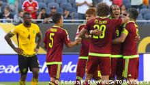 05.06.2016*** Jun 5, 2016; Chicago, IL, USA; Venezuela forward Jose Salomon Rondon (9) reacts with defender Rolf Feltscher (20) after the second half during the group play stage of the 2016 Copa America Centenario at Soldier Field. Venezuela defeats Jamaica 1-0. Mandatory Credit: Mike DiNovo-USA TODAY Sports Reuters/M. DiNovo/USA TODAY Sports