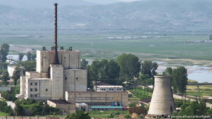 North Korea's key Yongbyon nuclear complex before its cooling tower (R) was demolished