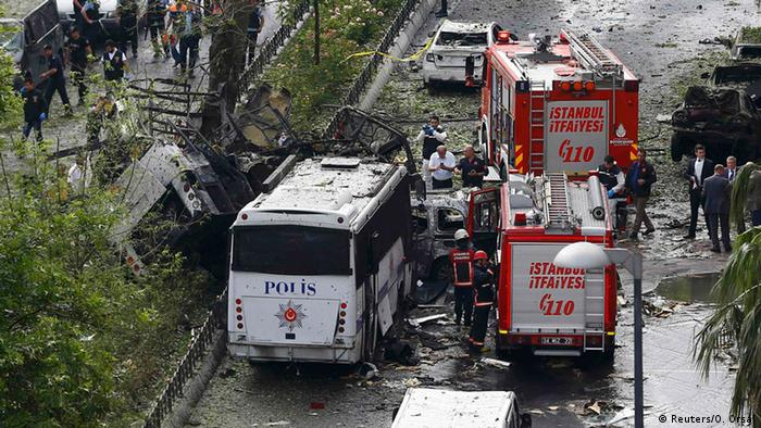 Fire engines stand beside a Turkish police bus which was targeted in a bomb attack in a central Istanbul