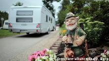 A garden gnome and a caravan