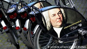 Rental bikes adorned by images of Bach