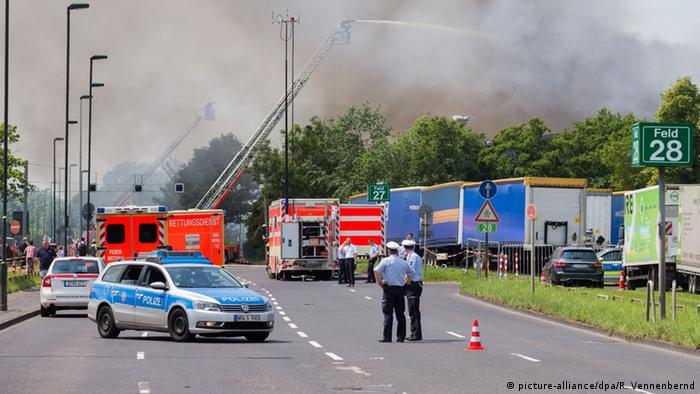 Fire crews try to extinguish a fire at a large refugee home in Düsseldorf
