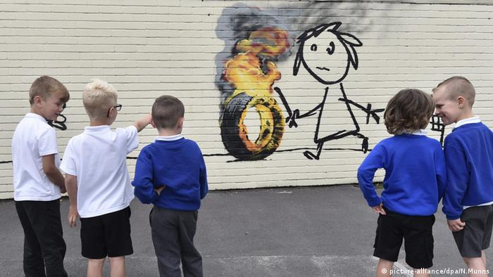 Banksy surprises Bristol school children with mural