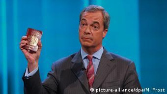 Nigel Farage holding a UK passport