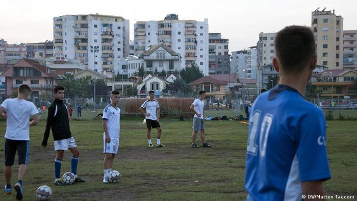 Boys play football at Dinamo football academy in Tirana