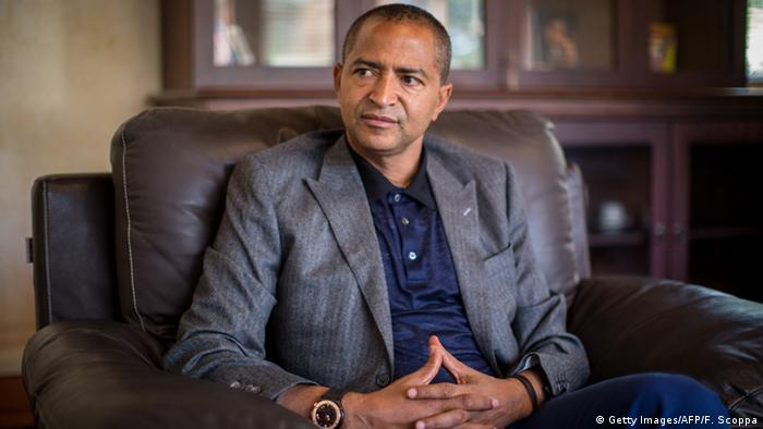 Congolese presidential hopeful Moise Katumbi on a leather sofa with his hands folded