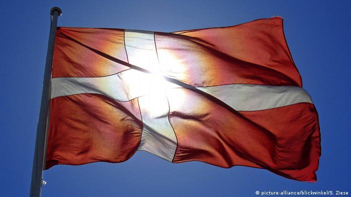 A Danish flag cast against sunlight