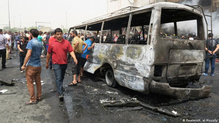 The burned out skleton of a bus is all that remains after suicide bombing in Baghdad.