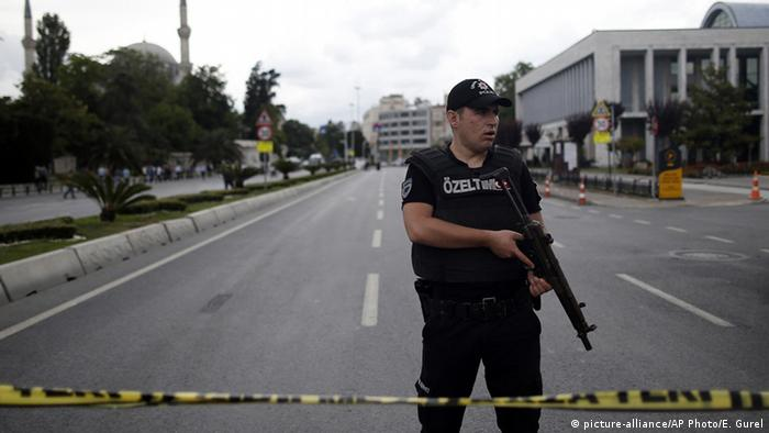 A Turkish policeman at the scene of the bombing in Istanbul