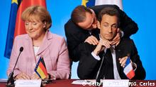 French President Nicolas Sarkozy (R), flanked by German chancellor Angela Merkel (L), listens to Italian Prime Minister Silvio Berlusconi as he participates in a final press conference at the end of working meeting to devise their own bailout packages for ailing banks and financial groups, on October 4, 2008 at the presidential Elysee Palace in Paris. As US President George W. Bush signed off on a 700-billion-dollar handout to Wall Street, the financial world's eyes turned to Europe in the hope of further generous measures to free up capital and reassure jumpy markets. AFP PHOTO / GERARD CERLES (Photo credit should read GERARD CERLES/AFP/Getty Images) (c) Getty Images/AFP/G. Cerles