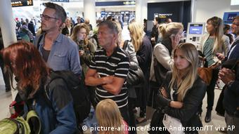 Passengers wait for flight information at Arlanda Airport domestic terminal