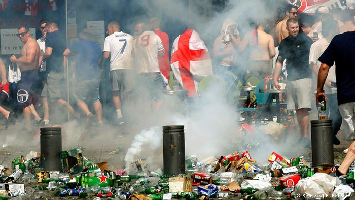 Russian and England fans fight at the end of the match at the Stade-Velodrome in Marseille