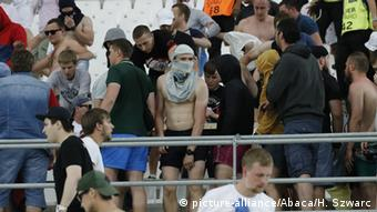 Russian and England fans fight at the end of the match at the Stade Velodrome in Marseille