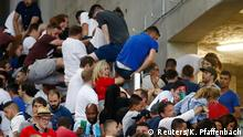 11.06.2016 *** Football Soccer - England v Russia - EURO 2016 - Group B - Stade Vélodrome, Marseille, France - 11/6/16 England fans climb over a fence to escape trouble in the stadium after the game REUTERS/Kai Pfaffenbach Livepic © Reuters/K. Pfaffenbach