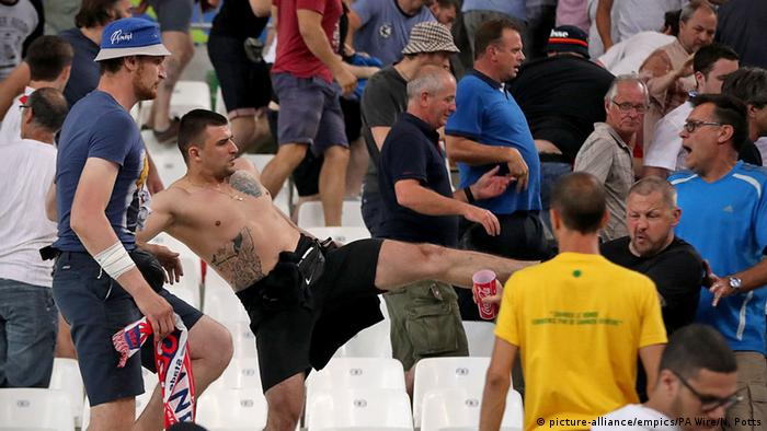 A fan tries to shove another from his seat at the England-Russia match