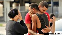 12.06.2016 *** Friends and family members embrace outside the Orlando Police Headquarters during the investigation of a shooting at the Pulse night club in Orlando, Florida Friends and family members embrace outside the Orlando Police Headquarters during the investigation of a shooting at the Pulse night club, where as many as 20 people have been injured after a gunman opened fire, in Orlando, Florida, U.S June 12, 2016. REUTERS/Steve Nesius TPX IMAGES OF THE DAY Copyright: Reuters/S. Nesius