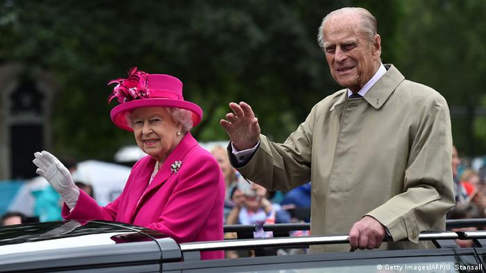 Queen Elizabeth and Prince Philip waving