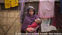 Bangladesch Dhaka Symbolbild Kinderehe junge Frau mit Baby